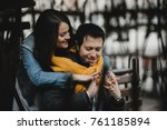 the pretty girl embracing her... | Shutterstock . vector #761185894