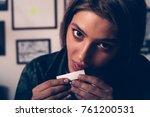 woman licking cigarette paper ... | Shutterstock . vector #761200531