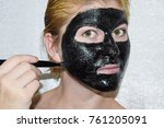 girl in a cosmetic black mask.... | Shutterstock . vector #761205091