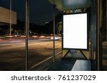Small photo of Advertisement light box mock-up at a bus stop at night. Marketing design.