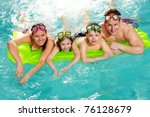 cheerful family in swimming... | Shutterstock . vector #76128679