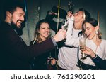 group of happy friends drinking ... | Shutterstock . vector #761290201