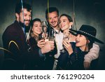 group of happy friends drinking ... | Shutterstock . vector #761290204