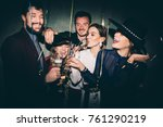 group of happy friends drinking ... | Shutterstock . vector #761290219