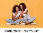 portrait of a two joyful afro... | Shutterstock . vector #761299039