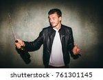 happy men opening bottle of... | Shutterstock . vector #761301145