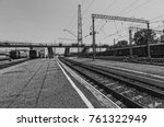 Small photo of black and white photo of railway wagons Laden with goods is on the station on the background of railway tracks. summer, bright sun and blue sky. rail waypoint arrow and semaphores.