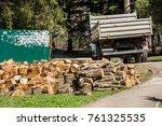 heap of wooden logs in a city... | Shutterstock . vector #761325535