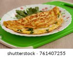 french omelette on a cutting... | Shutterstock . vector #761407255