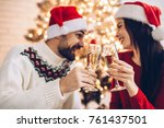 christmas couple cheers... | Shutterstock . vector #761437501