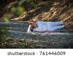 girl in the white doing yoga in ... | Shutterstock . vector #761446009