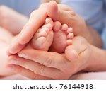 baby's feet in daddy's hands   Shutterstock . vector #76144918