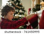 christmas stockings hanging by... | Shutterstock . vector #761450995
