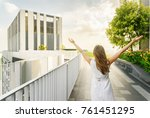 girl with raised arms to the... | Shutterstock . vector #761451295