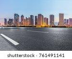 empty asphalt road through... | Shutterstock . vector #761491141