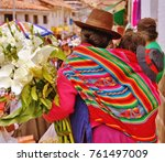 indigenous woman selling lilies ... | Shutterstock . vector #761497009