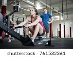 woman using rowing machine... | Shutterstock . vector #761532361