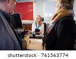 staff holding passport while... | Shutterstock . vector #761563774