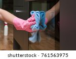 employee hand in rubber... | Shutterstock . vector #761563975
