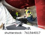 workers loading luggage in... | Shutterstock . vector #761564017