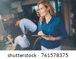 business woman using tablet in...   Shutterstock . vector #761578375