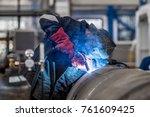 the welder in the mask welds... | Shutterstock . vector #761609425