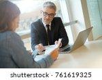 woman in banker's office... | Shutterstock . vector #761619325