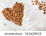 amonds heart. pile of nuts on... | Shutterstock . vector #761629015