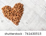 Small photo of Almond, heart, lot of almonds, Many almonds, Almonds background
