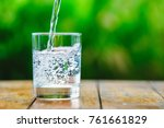 a glass of water on green... | Shutterstock . vector #761661829
