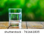 a glass of water on green... | Shutterstock . vector #761661835