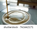 close up pouring syrup on... | Shutterstock . vector #761662171