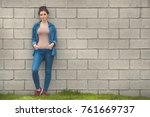 fashion woman in denim standing ... | Shutterstock . vector #761669737