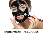 beautiful woman is applying... | Shutterstock . vector #761673055