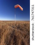 Small photo of orange windsock on Kansas prairie