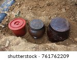 Small photo of Buried jars for storing Korean traditional food kimchi