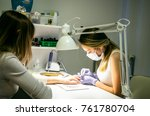 manicurist removing cuticle... | Shutterstock . vector #761780704