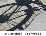 shadow of a bike on the road. | Shutterstock . vector #761795965
