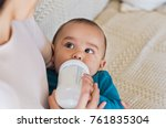 Cute Baby Drinking Milk From...