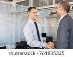 smiling businessmen shaking... | Shutterstock . vector #761835325