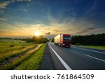 red truck driving on the... | Shutterstock . vector #761864509