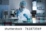 lab worker dripping sample onto ... | Shutterstock . vector #761873569