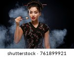 asian woman with sushi eating... | Shutterstock . vector #761899921