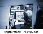 a man is watching screens in a... | Shutterstock . vector #761907535
