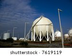 Gas storage spheres from an industrial storage facility - stock photo