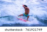 riding the waves. jaco beach ... | Shutterstock . vector #761921749