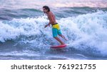 riding the waves. jaco beach ... | Shutterstock . vector #761921755