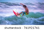 riding the waves. jaco beach ... | Shutterstock . vector #761921761
