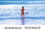 riding the waves. jaco beach ... | Shutterstock . vector #761934619