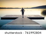 Man Standing On A Wooden...